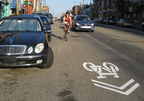 Example of a sharrow sign clearly marked on the road - BIKEPGH.ORG