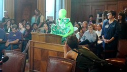"A protester testified as ""Sam the Snot"" in support of the paid sick days legislation. - PHOTO BY ASHLEY MURRAY"