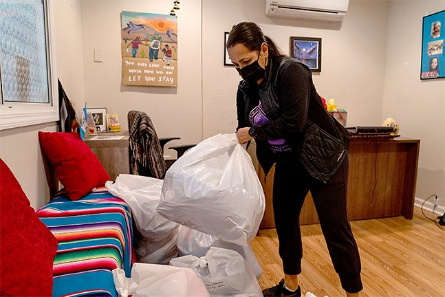 Monica Ruiz organizes a coat drive for Casa San Jose. - CP PHOTO: LAKE LEWIS