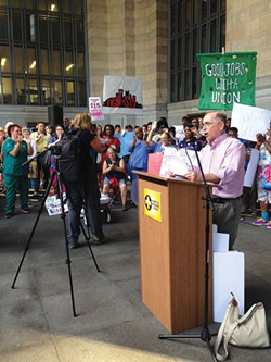 Barney Oursler, of Pittsburgh United, leads a rally for fair pay and unionization for hospital workers. - PHOTO BY RYAN DETO