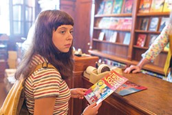 Minnie (Bel Powley) shops for comix.