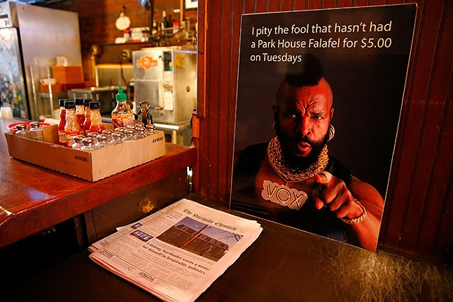 "A sign of Mr. T that reads, ""I pity the fool that hasn't had a Park House Falafel for $5.00 on Tuesdays,"" hanging inside the Park House - CP PHOTO: JARED WICKERHAM"
