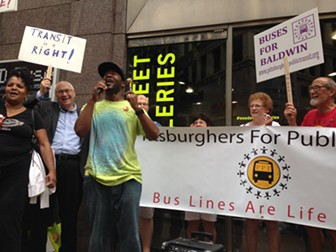 Darnell Jones, of Groveton, speaks at a rally celebrating the renewed bus service to his community. - PHOTO BY RYAN DETO