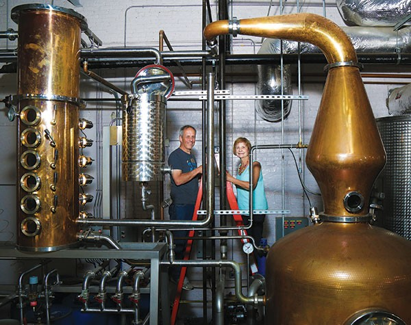 Photo by Theo Schwarz - MARK MEYER AND MARY ELLEN MEYER, TWO OF THE CO-OWNERS, STAND AMID THE PIPES FLOWING WITH ALCOHOL