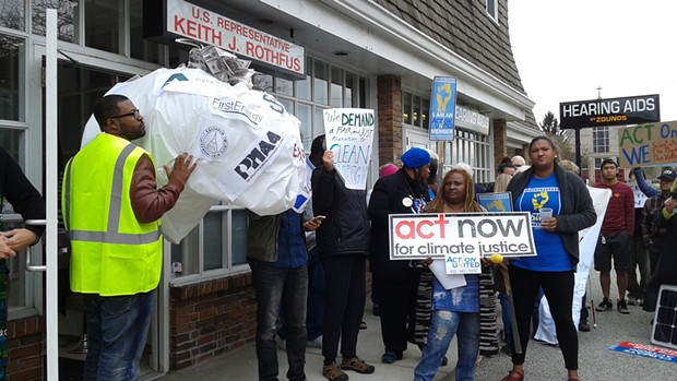 """Pittsburgh Climate Movement protesters delivered a bag of """"dirty"""" money to U.S. Rep. Keith Rothfus' local office. - PHOTO BY ASHLEY MURRAY"""
