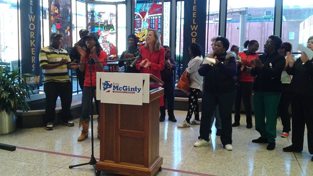 """U.S. Senate hopeful Katie McGinty claps along as local workers chant """"I believe we will win,"""" after she announced her support for a $15 minimum wage. - PHOTO BY ASHLEY MURRAY"""