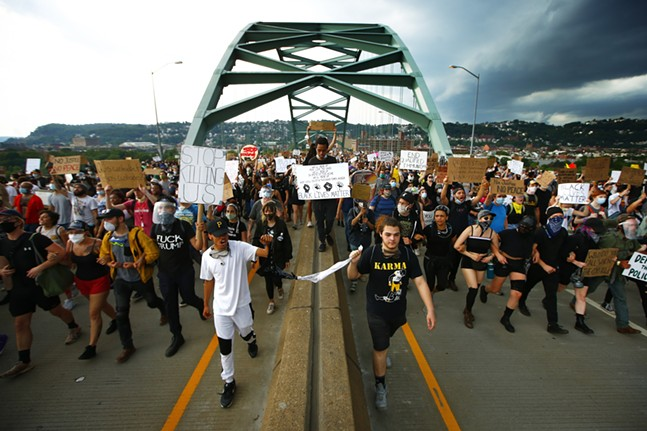 Protesters peacefully march through Downtown, the South Side, through the Hill District, and back Downtown on Thu., June 4, 2020. - CP PHOTO: JARED WICKERHAM
