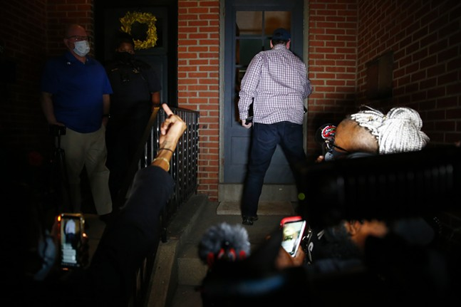 A protester gestures to Mayor Bill Peduto after leaders from the Black community met with him on his doorstep before clashing with Pittsburgh Police near Mellon Park after being told to leave the Point Breeze neighborhood on Wed., Aug. 19, 2020. - CP PHOTO: JARED WICKERHAM