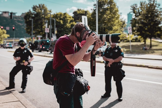 """Photojournalist Jared Wickerham covering a """"Civil Saturday"""" protest downtown on July 4, 2020 - PHOTO BY JOSH MASSIE/SCATTEREDPICTURES.MYPORTFOLIO.COM"""