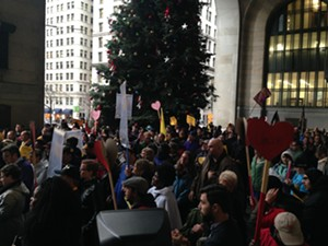 Service workers fill the entryway of the City-County Building as protesters and elected officials speak. - PHOTO COURTESY OF RYAN DETO