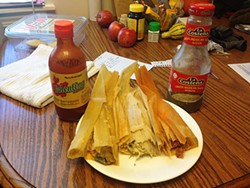 Three different varieties of tamales: spicy pork, marinated chicken, and cheese with peppers - PHOTO BY RYAN DETO