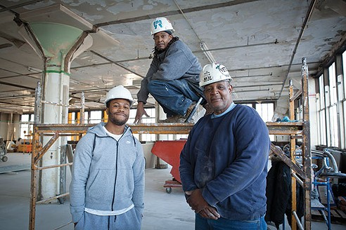 CEA construction instructor and Ma'at foreman Johnnie Comer (right), standing with Homewood natives Woody Yates (center) and Adrian Foster (left), on one of the floors they are remodeling at the 7800 Susquehanna Street warehouse renovation project. - PHOTO BY HEATHER MULL
