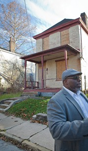 Rashad Byrdsong tours a particular section of Homewood near Westinghouse Academy that has seen especially large amounts of blight and violence over the years. - PHOTO BY HEATHER MULL