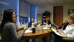 "New mentors meet to learn about ""3 Cups of Coffee."" - PHOTO BY ASHLEY MURRAY"