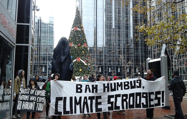 """Protesters marched with a 12-foot """"Ghost of Climate Future"""" in downtown Pittsburgh this week. - PHOTO BY ASHLEY MURRAY"""