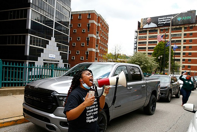 More than twenty cars blocked Second Avenue outside of the Allegheny County Jail as people protested conditions for Black women, calling for the release of inmates and ending the use of cash bail on Tue., May 12, 2020. - CP PHOTO: JARED WICKERHAM