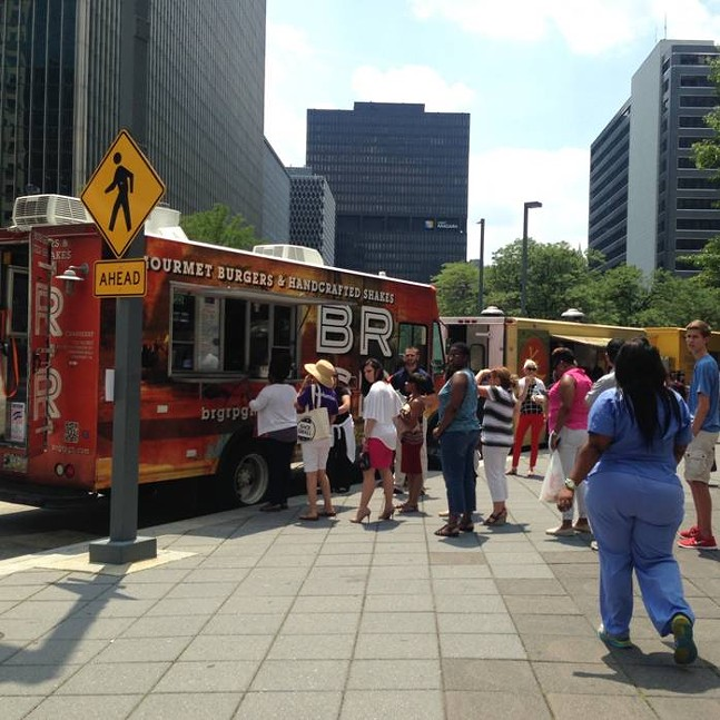 Downtown workers flock to a food-truck roundup this past summer. - PHOTO BY LISA CUNNINGHAM