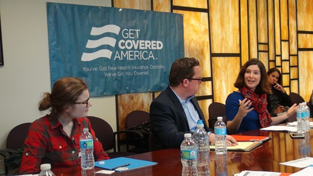 """Enroll America President Anne Filipic (right) speaks with local Affordable Care Act """"navigators"""" about the final push before open enrollment deadline. - PHOTO BY ASHLEY MURRAY"""