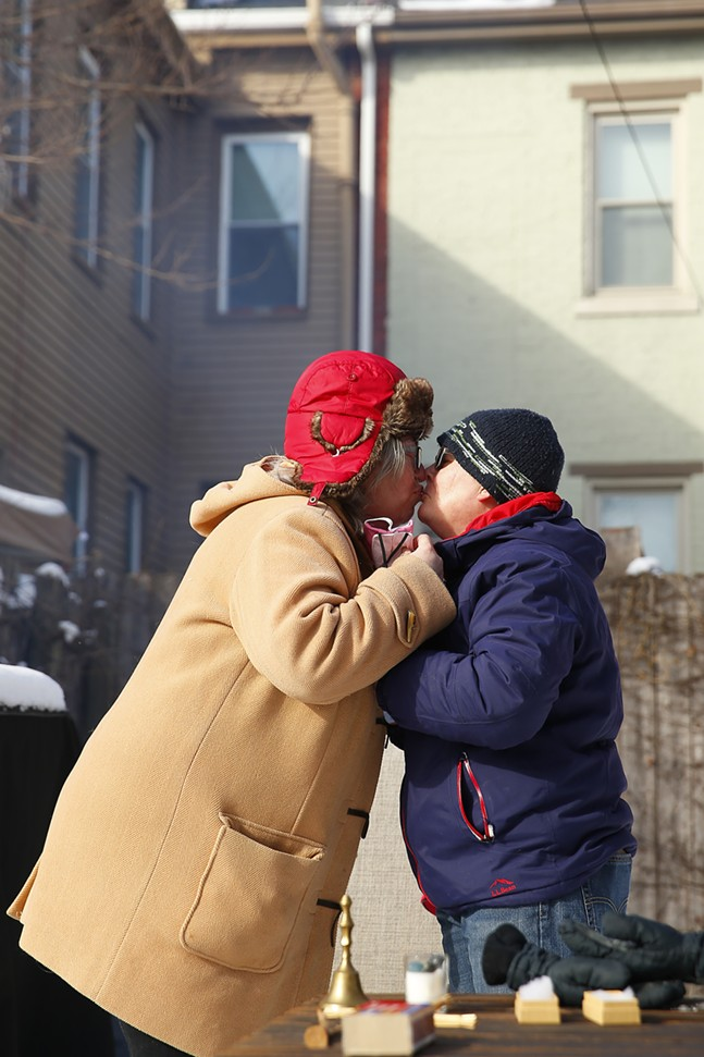 Sue Kerr and Laura Dunhoff remove their masks briefly to kiss. - CP PHOTO: JARED WICKERHAM