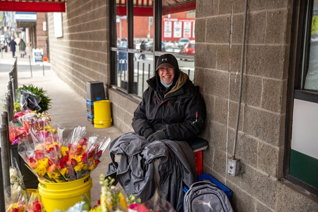Troy Thomas sells flowers outside of Wholey's Market in the Strip. - CP PHOTO: KAYCEE ORWIG