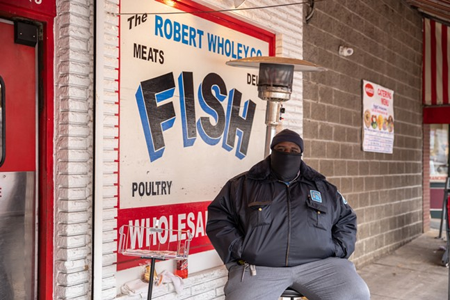 Security guard Dalonte Winters manages the line outside of Wholey's Market. - CP PHOTO: KAYCEE ORWIG