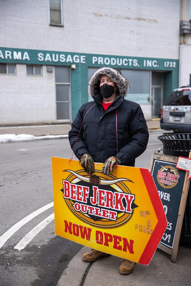 """Chris Lageman speaks of his experiences talking to """"people from different walks of life"""" while advertising for the Beef Jerky Outlet in the Strip District. - CP PHOTO: KAYCEE ORWIG"""