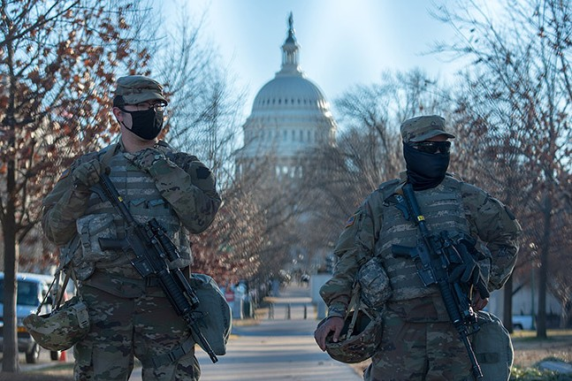 Armed National Guardsmen on security detail at the U.S. Capitol on Jan. 19