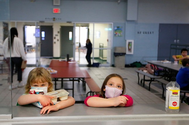 June Radder (left), 6, and Cylvia Feigelstein (right), 6, wait in line for their meals at the Boys & Girls Club. - CP PHOTO: JARED WICKERHAM