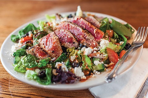 Ahi tuna salad: Sesame-crusted seared tuna with a spicy teriyaki drizzle and feta cheese - PHOTO BY VANESSA SONG