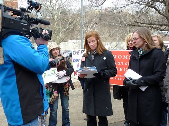 Patrice Tomcik of Moms Clean Air Force addresses the media about a new report that questions the proximity of fracking sites to schools and residences. - PHOTO BY ASHLEY MURRAY