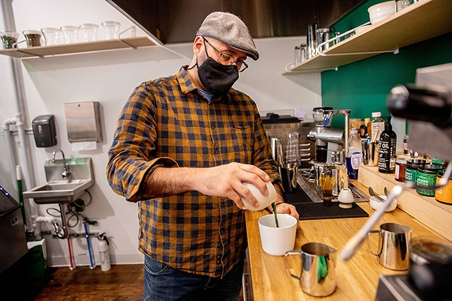 Jorge Broche, co-owner of Mosaic Leaf Matcha Tea Bar, prepares a matcha latte. - CP PHOTO: KAYCEE ORWIG