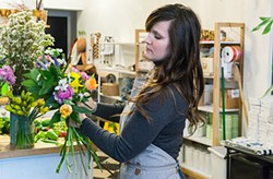 The Farmer's Daughter Flowers' owner Lauren Work Phillips creates a bridal bouquet - PHOTO BY AARON WARNICK