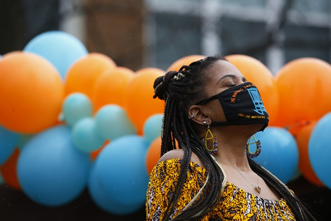 Dannielle Brown closes her eyes and points her head to the sky during an event announcing the end of her hunger strike and the launch of the Marquis Jaylen Brown Foundation at Freedom Corner. - CP PHOTO: JARED WICKERHAM