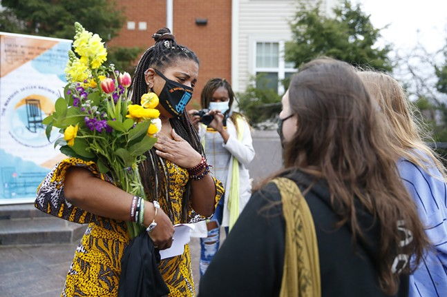 Supporters give flowers to Dannielle Brown. - CP PHOTO: JARED WICKERHAM