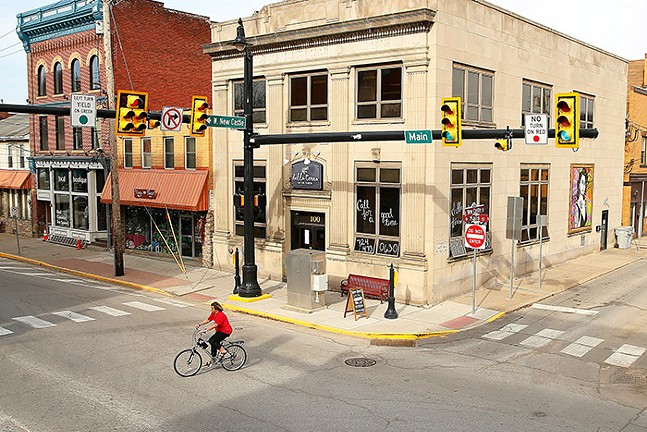 A cyclist rides along Main Street in Zelienople, Pa. - CP PHOTO: JARED WICKERHAM