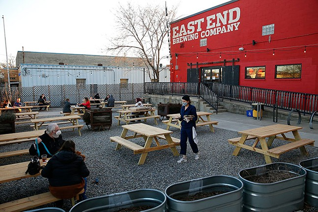 Patrons eat and drink beers outside of East End Brewing Company. - CP PHOTO: JARED WICKERHAM