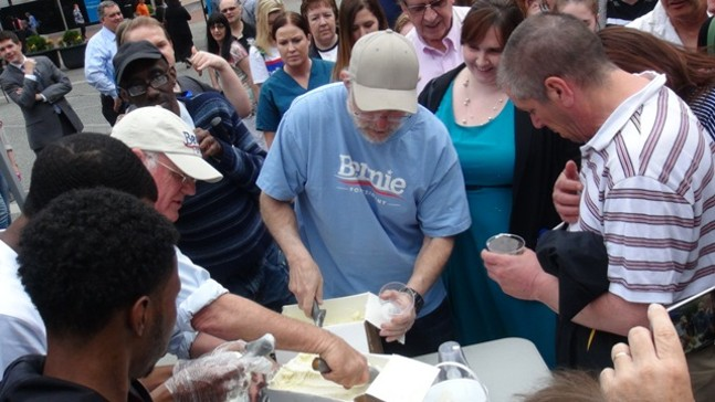 Ben Cohen, in Bernie hat on left, and Jerry Greenfield, in Bernie shirt, scoop free ice cream in Pittsburgh's Market Square today to campaign for presidential candidate Bernie Sanders. - PHOTO BY ASHLEY MURRAY