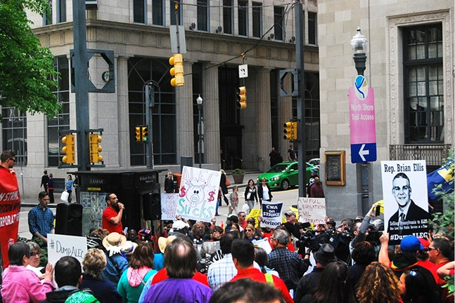 A large crowd gathered outside the Omni William Penn Hotel Friday  to protest a meeting of members of ALEC (American Legislative Exchange Council) - PHOTO BY REBECCA NUTTALL
