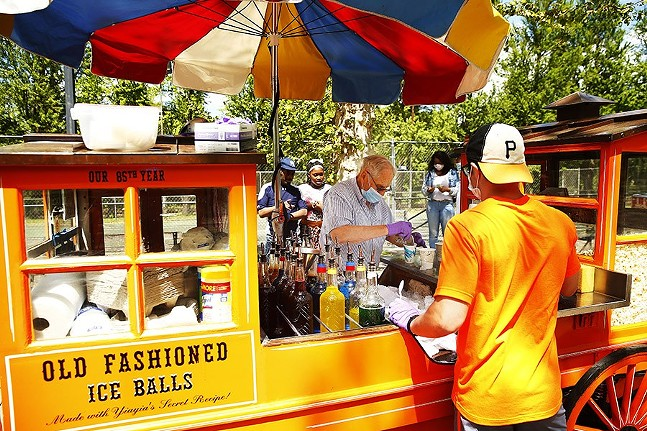 Gus Kalaris, owner of Gus & Yiayia's food cart, serves up old-fashioned shaved ice balls with employee Matt Szymanowski in the North Side in May 2020. - CP PHOTO: JARED WICKERHAM