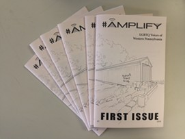 Copies of the AMPLIFY zine - PHOTO BY RYAN DETO