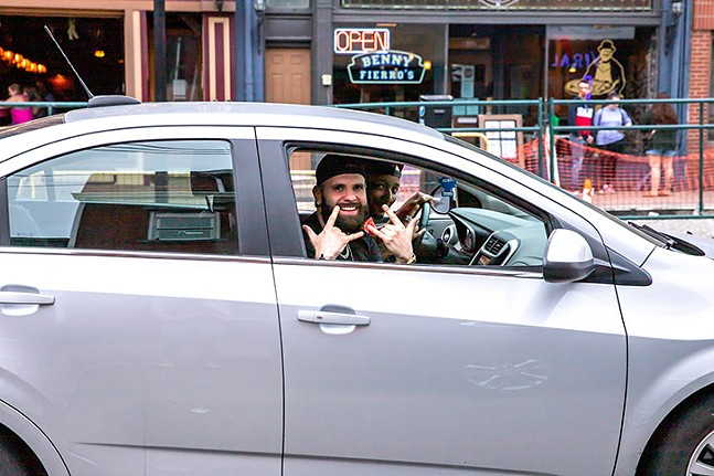 People posing at a red light from a car on East Carson Street. - CP PHOTO: KAYCEE ORWIG