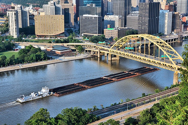 Coal barge riding up the Monongahela River in Pittsburgh