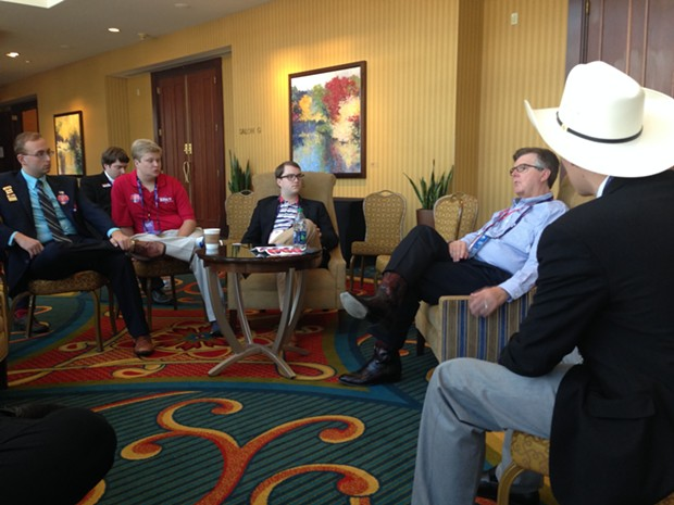 Texas Lt. Governor Dan Patrick, right in blue shirt, talks to a group of young Republicans Wednesday afternoon at the RNC in Cleveland - PITTSBURGH CITY PAPER PHOTO BY RYAN DETO