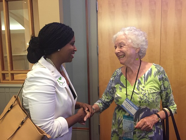 Ayanna Presley shakes hands with a fellow female delegate - PHOTO COURTESY OF EMERGE AMERICA