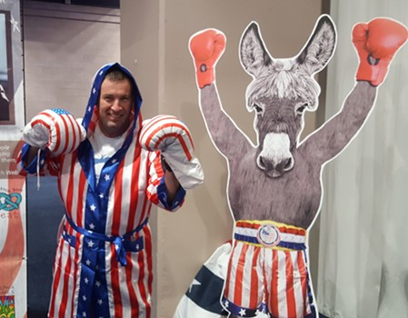 South Carolina delegate Jeff Mars - hall tries on a robe from Rocky - PHOTO BY REBECCA ADDISON