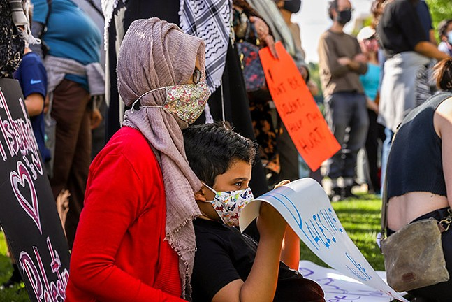 Demonstrators gather for a Stand in Solidarity with Palestine protest outside the Cathedral of Learning in Oakland. - CP PHOTO: KAYCEE ORWIG