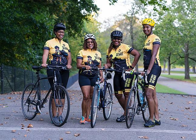 Members of Black Girls Do Bike showing their new custom kits. - PHOTO: MONICA GARRISON