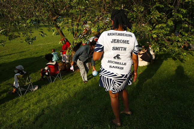 Ikhana-hal-nakina wears a shirt remembering her brother and friend who were killed by police. - CP PHOTO: JARED WICKERHAM