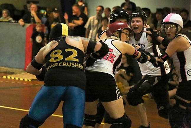 Roller Derby Action at the Romp n' Roll in August - PHOTO BY STEPHEN CARUSO