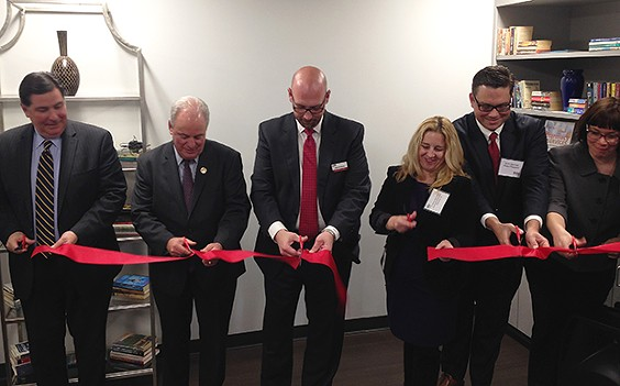 Pittsburgh Mayor Bill Peduto (left), U.S. Congressman Mike Doyle (center left), and PATF CEO Sean DeYoung (center) cut the ribbon on new PATF facility. - CP PHOTO BY RYAN DETO